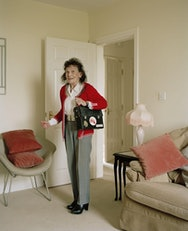 Older lady in living room with bag