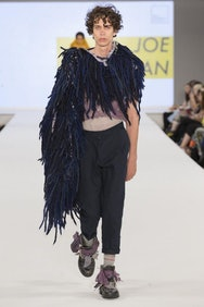 Model wearing a fluffy blue top