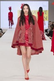 Model wearing red stripy dress