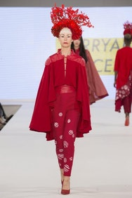 Model wearing red top and trousers