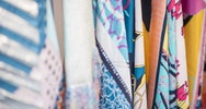 A close up of mixed patterns on textiles