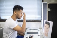Acting student putting on make-up