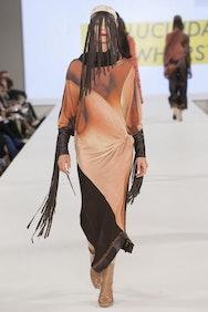 Model wearing brown coloured dress