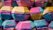 Colourful Lush bath bombs stacked on top of each other