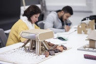 Students working on an architecture model
