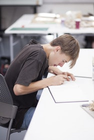Student drawing an architecture model