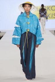 Light blue rain coat with dark blue leggings