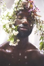 Man wearing flower headband