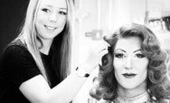student applying hair and makeup