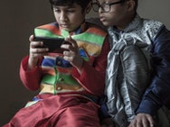 Boys playing on a phone