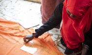 RNLI International - Women laying down orange fabric