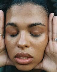 Women holding her face
