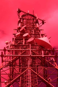 red photo scaffolding and satellite dish tower
