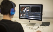 Student using Adobe Premier Pro on an iMac, making a short film