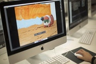 Student using Adobe Premier Pro on an iMac, making a short film