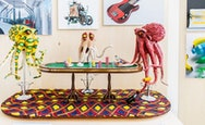 Three brightly coloured octopuses playing poker
