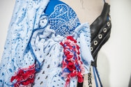 Mixed media textiles bodice work on a mannequin using blue wool and black leather