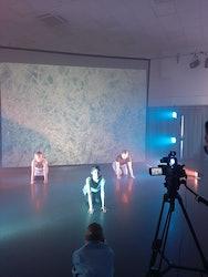 Dancers in Uranus setting ready to be filmed