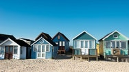 Colourful beach huts on the sand