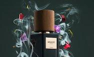 perfume bottle surrounded by smoke