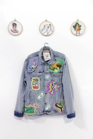 Denim jacket with colourful patches