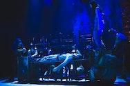 Actors on a dark stage