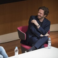Director and AUB Alumni, Edgar Wright, smiling during an interview for Film Production Students