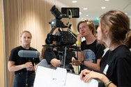 Students operating a camera