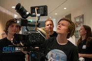 Student looking at the camera monitor
