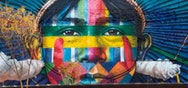 Mural with a face made up with multiple colours