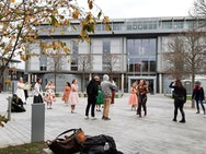 Dancers outside university filming Grease
