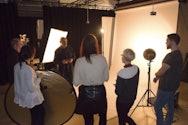 Tutor teaching a photography class.