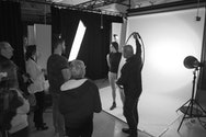 Student's working in a photography studio taking photographs of a model