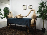 photo of a sculpture of two objects sitting at a table