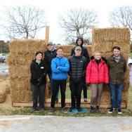 AUB Human volunteers stood by a straw bale