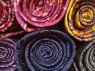A close up of several fabrics