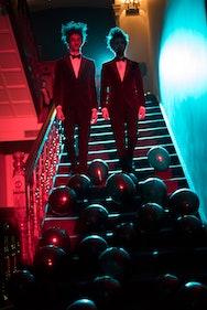 Actors walking down stairs